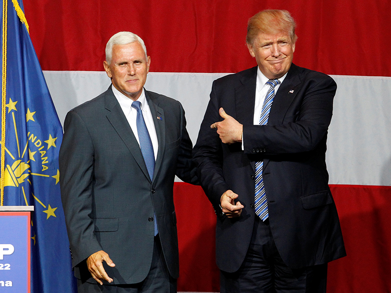Republican presidential candidate Donald Trump and Indiana Governor Mike Pence wave to the crowd before addressing the crowd during a campaign stop at the Grand Park Events Center in Westfield