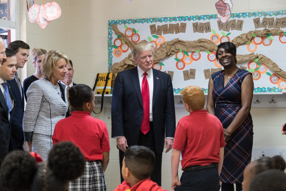 President Donald Trump participates in a tour of Saint Andrews Catholic School