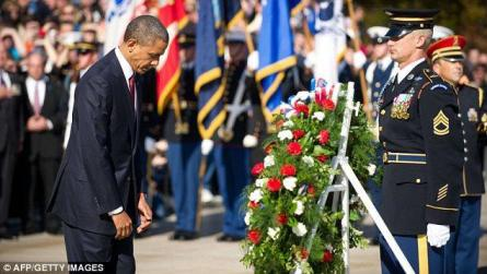 Bow: Obama stands before the wreath before placing it on the Tomb of the Unknowns at Arlington Naional Cemetery